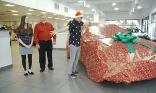 Car wrapped in Christmas paper