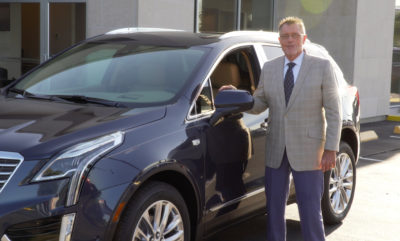 Nice Car Salesman with Cadillac